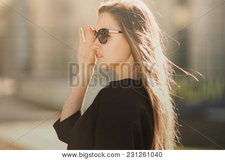 Confident Business Woman Wearing Sunglasses On The Background Of A Business Center.photo Has Empty S