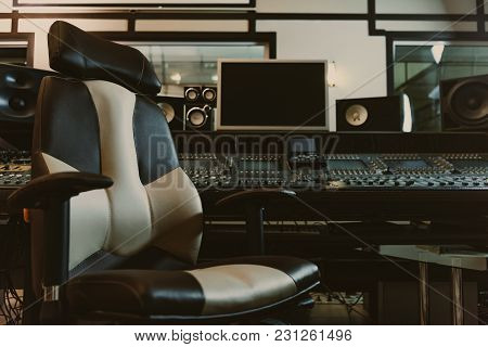 Armchair In Front Of Graphic Equalizer At Recording Studio