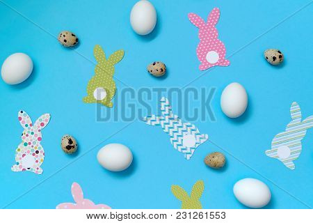 Easter Bunny Decoration And Eggs On Blue Background, Copy Space. Diy Holiday Handicraft Of Colorful