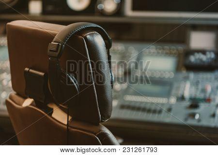 Headphones Hanging On Armchair At Recording Studio