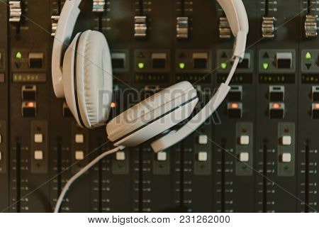 Top View Of Headphones On Graphic Equalizer At Recording Studio
