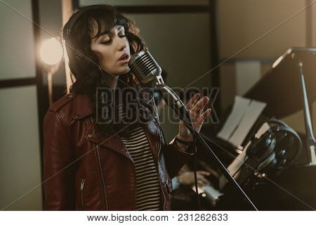 Sensual Female Singer Performing Song At Recording Studio