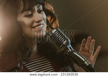 Attractive Young Female Singer Performing Song And Smiling