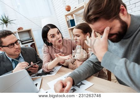 Young Woman With Little Girl Holding Teddy Bear, Discusses With Man In Office Of Psychologist. Adult