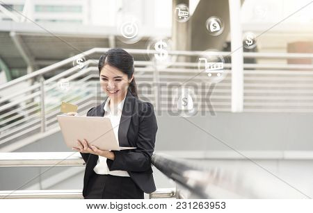 Businesswoman Using Computer And Credit Card For Shopping Online. Internet Banking And E-commerce Te