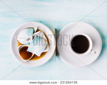 Broken Coffee Cup And Whole One. Relationship Concept Top View Over Pastel Background. Flat Lay
