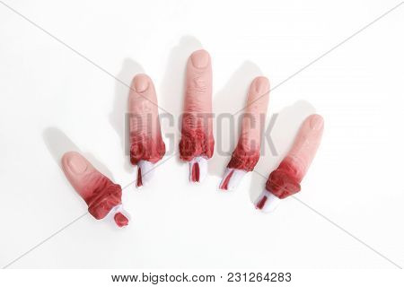 5 Fake Bloodied Plastic Fingers As If They Had Been Torn Off On A White Background. Reconstituted Ha