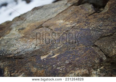 Brown stone background. Stone background. Stone texture. Grunge stone. Rock background. Grunge style. Rock.