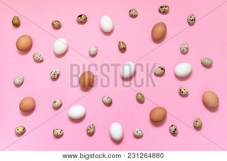 Hen White And Brown Eggs And Quail Eggs On Pink Background, Copy Space. Healthy Food Concept. Top Vi