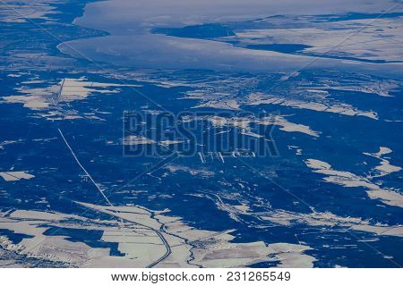 Aerial Photography From The Height Of The Aircraft Rivers In The Ice And Fields In The Snow In Russi