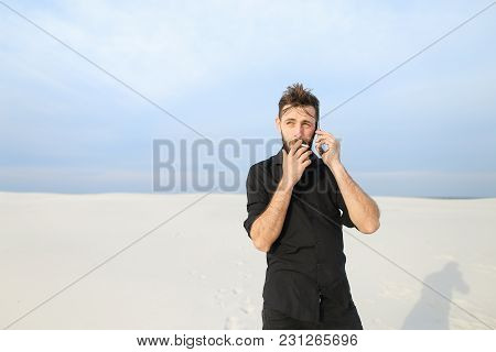 Husband Speaking On Smartphone With Wife In Business Trip Smoking, Guy Go For Walk To Seaside. Beard