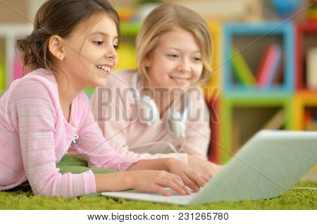 Two Cute Little Girls Using Laptop Together