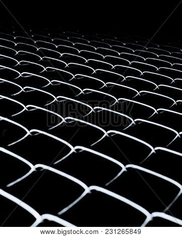 Black Background With Fence Mesh. Abstract Background