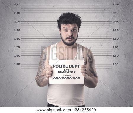 Caught gangster in jail with table on his hand.