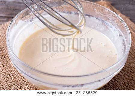 Dough For Crepes Or Pancakes In Glass Bowl On The Table