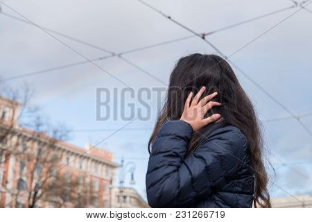 Horizontal Picture Of Long Hair Woman Looking The Rainbow In Vatican City, Italy