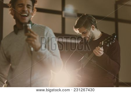 Young Rock Band Musicians Performing Song Together
