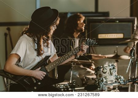 Young Rock Band Musicians Performing Song On Repetition