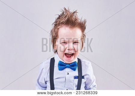 The Little Boy Screams And Smiles In A Blue Bow Tie And Suspenders For Any Purpose