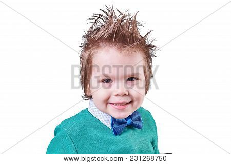 Beautiful Little Boy In Blue Bow Tie And A Green Sweater, Smiling Isolated On White Background For A