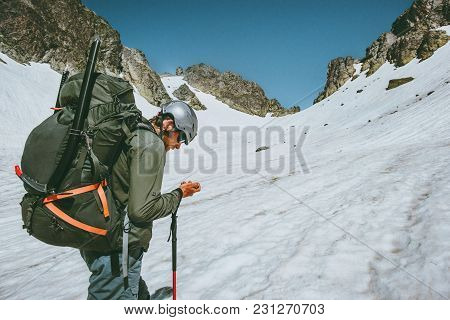 Man Adventurer With Gps Tracker Navigator Checking Location Coordinates Climbing In  Mountains Exped