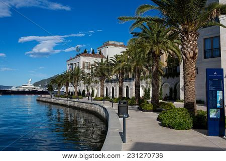 Tivat, Montenegro - September 21: Long Promenade With Yachts With Palm Trees And Hotels In The Europ