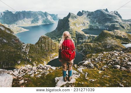 Woman Alone With Backpack Exploring Mountains Of Norway Traveling Healthy Lifestyle Adventure Concep