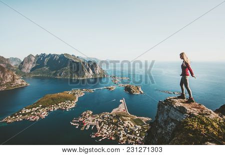 Woman Traveler Standing Alone On Cliff Edge In Norway Lifestyle Exploring Concept Adventure Outdoor