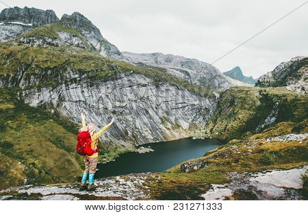 Happy Woman Raised Hands With Backpack Hiking At Lake In Mountains Of Norway Travel Lifestyle Advent