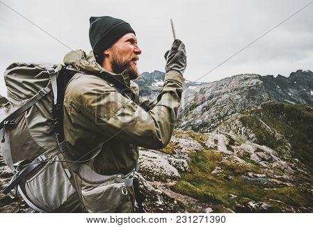 Man Traveler Using Smartphone Gps Navigator Checking Location Coordinates Hiking In Mountains With B