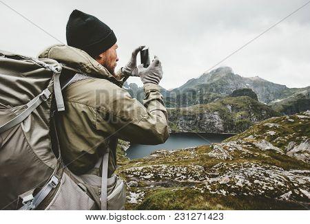 Man Traveler Checking Smartphone Gps Navigator Hiking In Mountains Travel Survival Lifestyle Concept