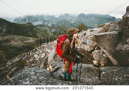 Traveler Woman With Backpack On Hermannsdalstinden Mountain Summit In Norway Travel Lifestyle Wander