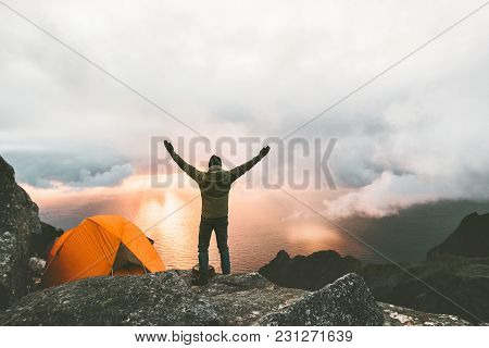 Man Traveler Happy Raised Hands On Mountain Top Near Of Tent Camping Outdoor Travel Adventure Lifest