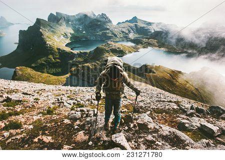 Traveler Man Climbing To Hermannsdalstinden Mountain Top In Norway Traveling Lifestyle Adventure Con