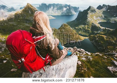 Tourist Woman Relaxing Alone With Backpack In Mountains Norway Traveling Healthy Lifestyle Adventure