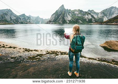 Woman With Map And Backpack Planning Route Sightseeing Lofoten Islands In Norway Solo Travel Lifesty