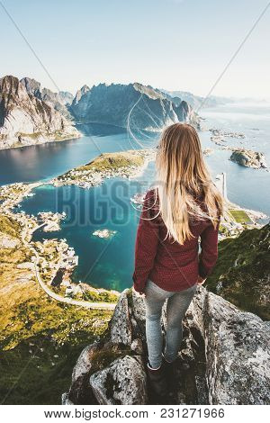 Woman Tourist Traveling In Norway Standing On Cliff Mountain Aerial View Lofoten Islands Lifestyle E