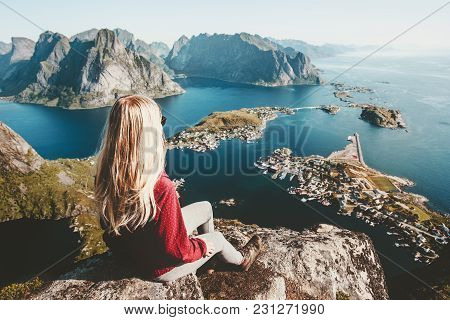 Blonde Woman Relaxing On Cliff Mountain Top Traveling In Norway Lifestyle Exploring Concept Adventur