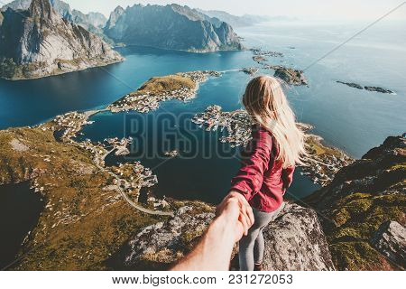 Traveling Couple Follow Holding Hands On Cliff Mountain In Norway Lifestyle Concept Summer Vacations