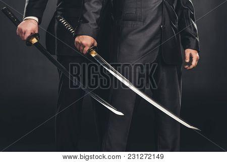 Cropped Shot Of Modern Samurai With Katana Swords Isolated On Black