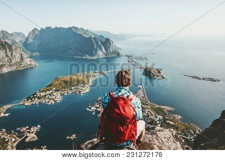 Man Sitting On Cliff Edge Alone Enjoying Aerial View Backpacking Lifestyle Travel Adventure Outdoor