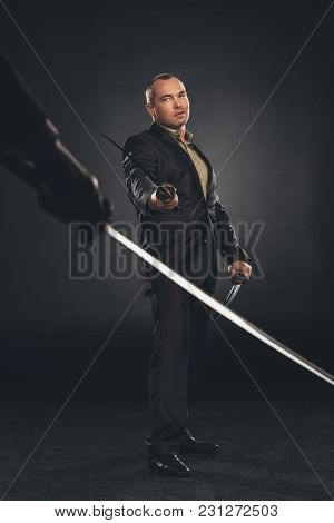 Modern Samurai In Suit Ready To Fight On Black