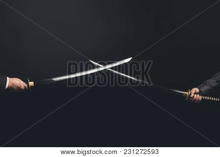 Cropped Shot Of Samurai With Crossed Swords Isolated On Black