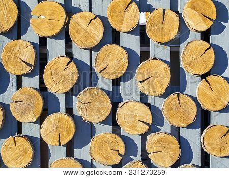 Texture Of Wood Logs Background In The Fence