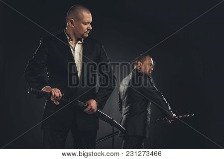 Two Handsome Modern Samurai With Katanas Isolated On Black