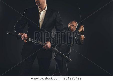 Two Mature Modern Samurai With Katanas Isolated On Black