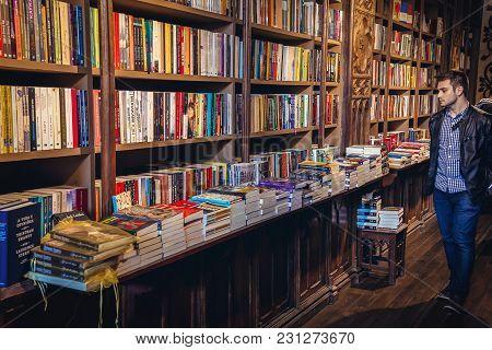 Porto, Portugal - November 13, 2017: Man In Lello Bookstore In Porto, Considered To Be One Of The Mo
