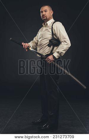 Side View Of Yakuza Member Taking Out His Katana Sword