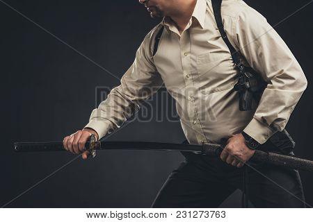 Cropped Shot Of Yakuza Member Taking Out His Katana Sword