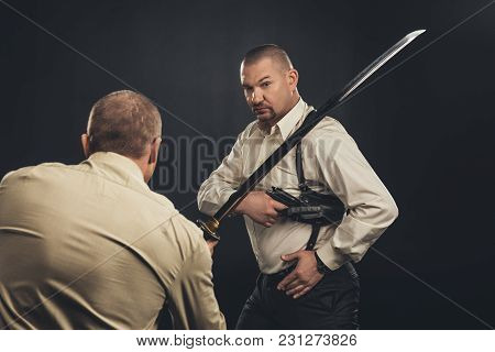 Mafia Members Fighting With Gun And Katana Sword On Black